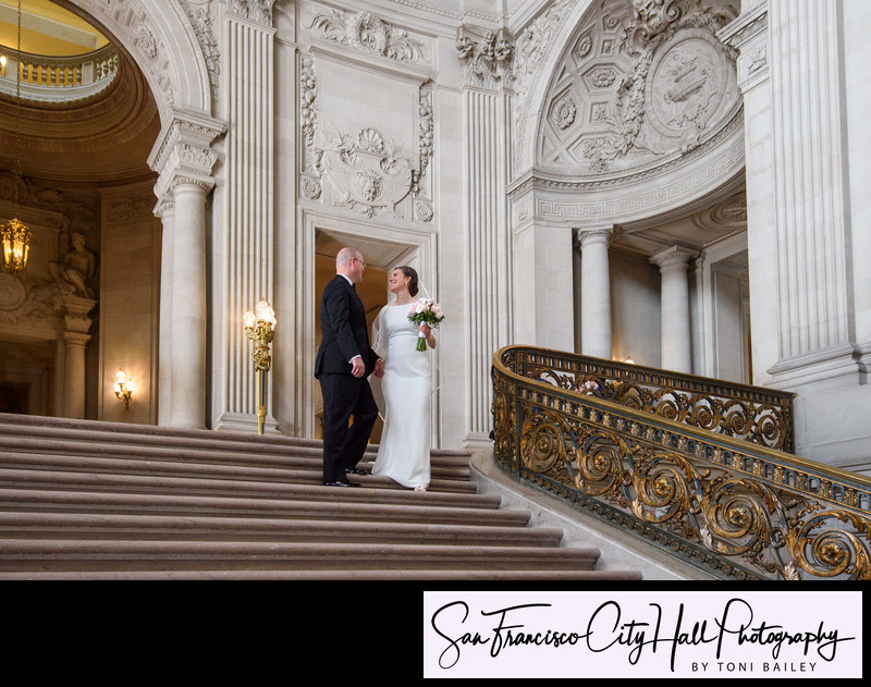 grand staircase with bride and groom walking down stairs