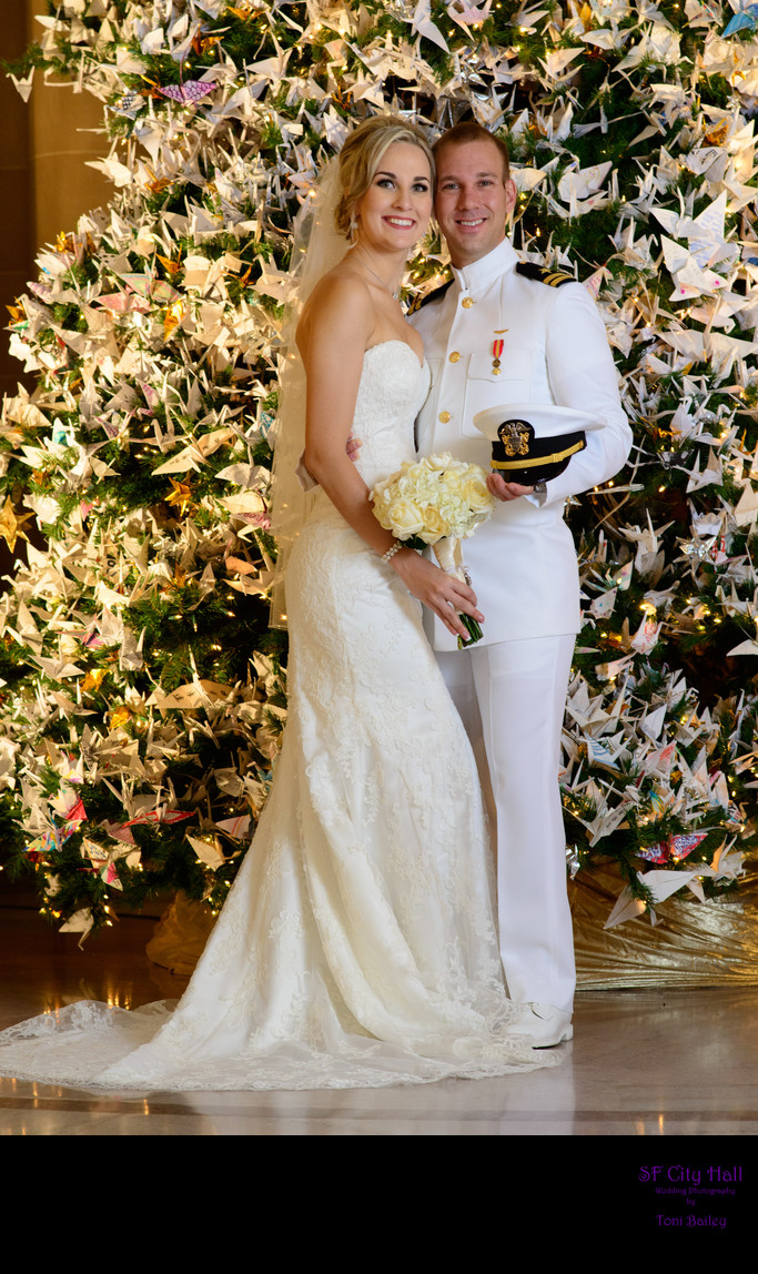 Beautiful decorated Christmas Tree with bride and groom