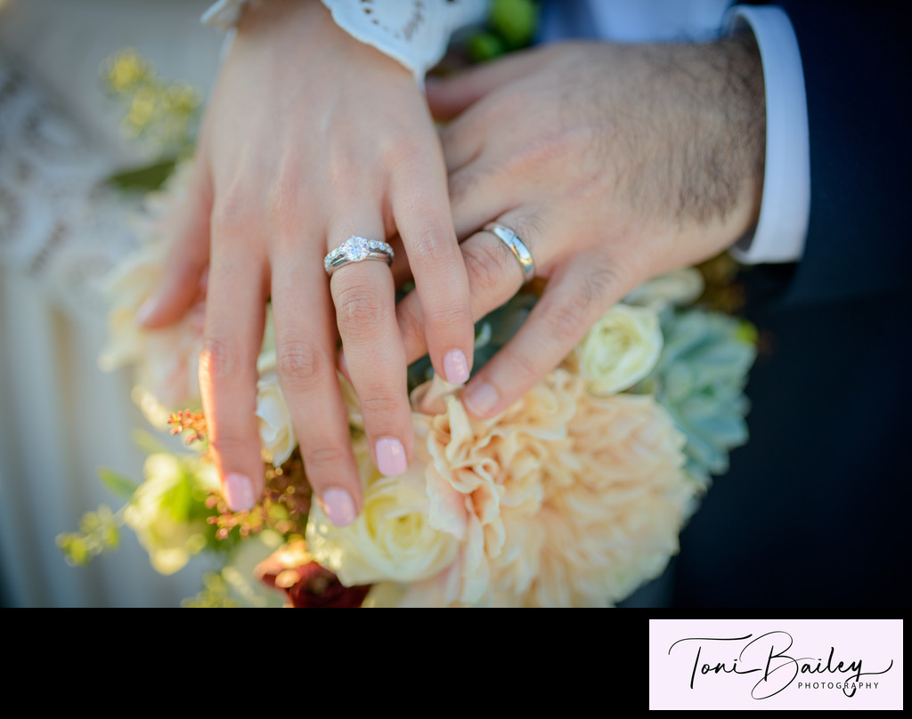His and hers wedding rings with flowers