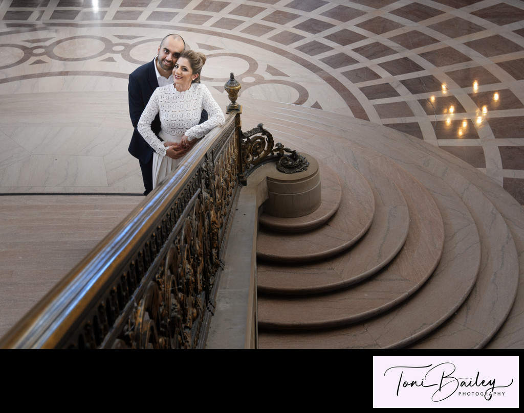 Amazing railing photo with bride and groom