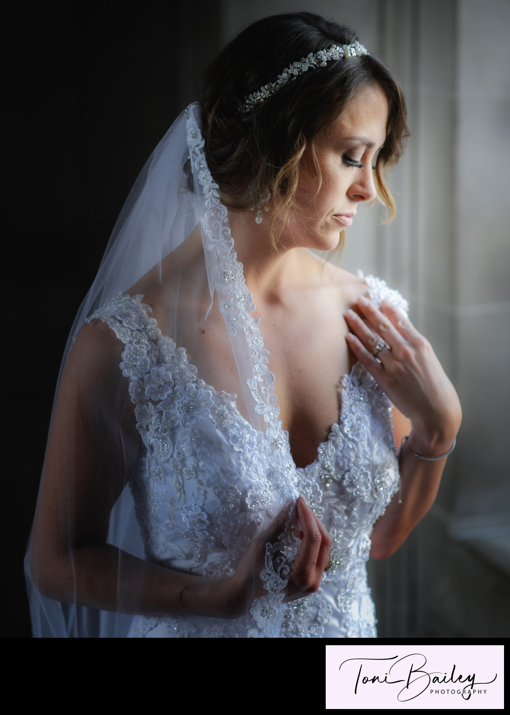 Beautiful bride showing her ring