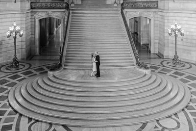 grand staircase wedding kiss