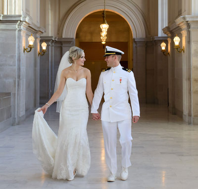 Couple walking in City Hall after their wedding