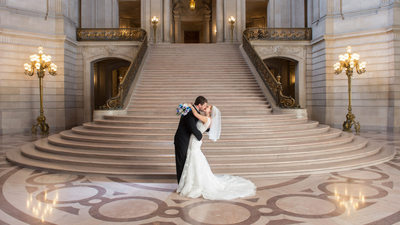 San Francisco City Hall Wedding Photographer - Staircase Kiss