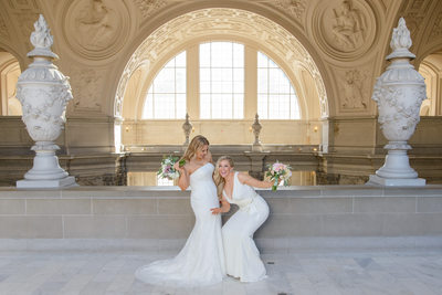 Same-sex Brides having fun on their wedding day in San Francisco