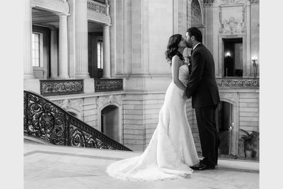 kiss at the top of city hall stairs