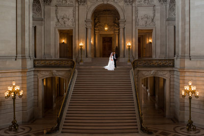 night grand staircase wedding photo