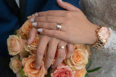 wedding-rings-and-flowers-peach