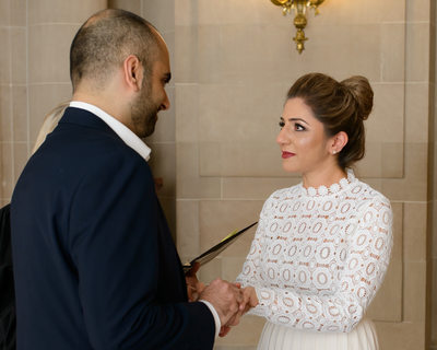 Exchanging wedding vows at City Hall