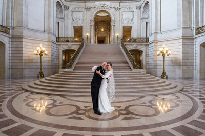 City Hall wedding photography grand staircase with happy couple