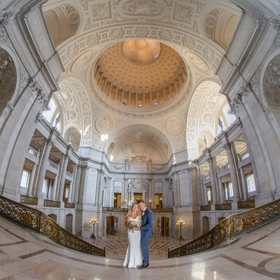 San Francisco City Hall Wedding Photographer - Bride and groom under Rotunda