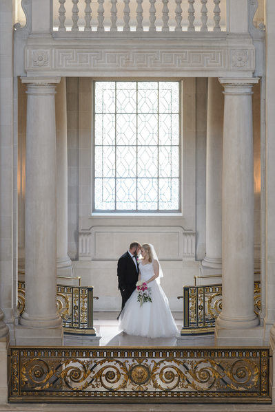 romantic wedding photograph of  couple at San Francisco City Hall