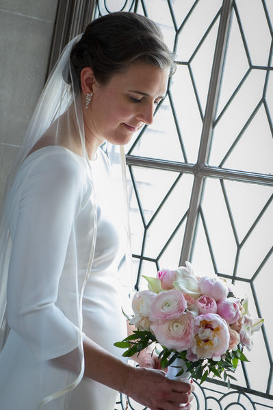 bride and bouquet in city hall light