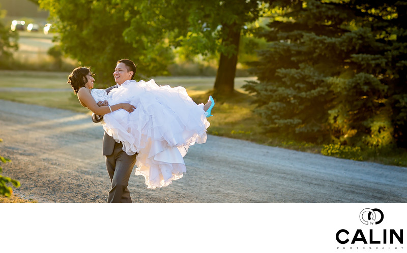 Groom Carries Bride at Country Heritage Park Wedding