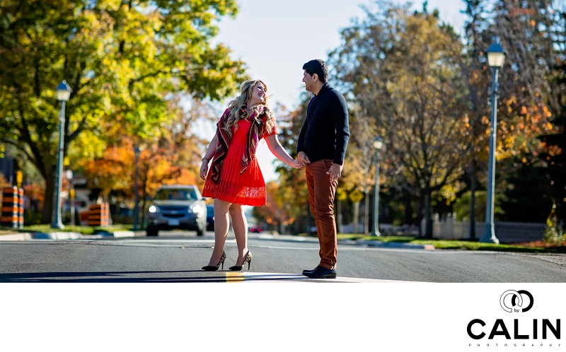 Engagement Photo of Couple Crossing a Stret
