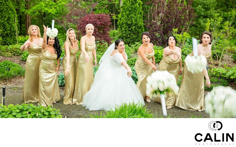 Bridal Party Throw Bouquets at Photographer