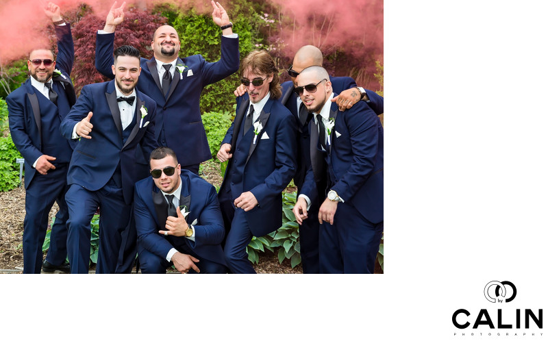 Groomsmen Have Fun With Red Smoke