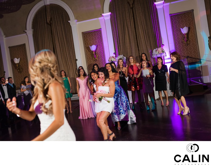 Maid of Honour Catches Bouquet at Liberty Grand Wedding