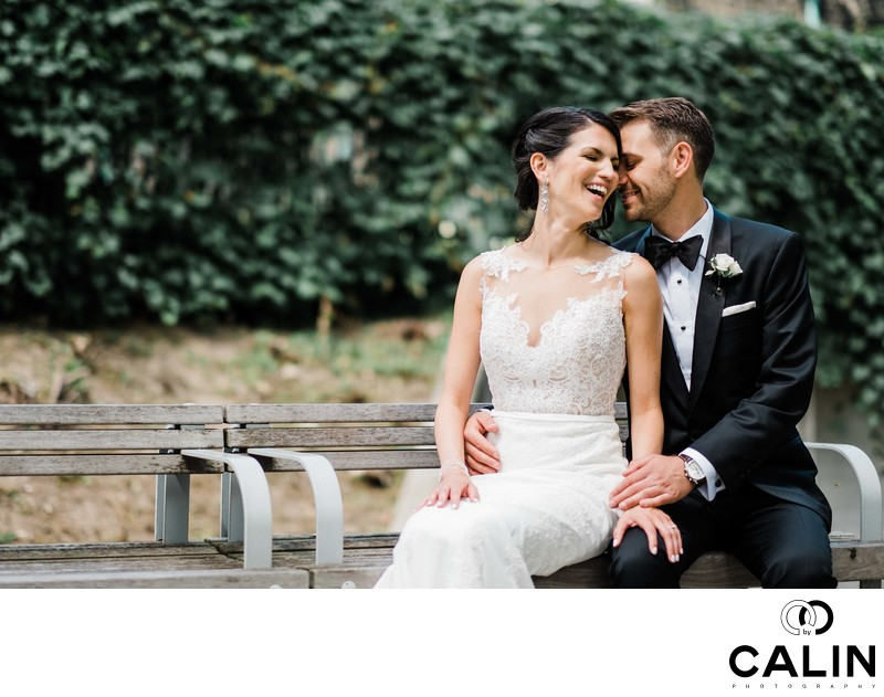 Bride and Groom Sit on a Bench at Storys Building Wedding