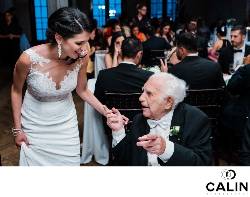 Bride and Grandpa Chat at Storys Building Wedding