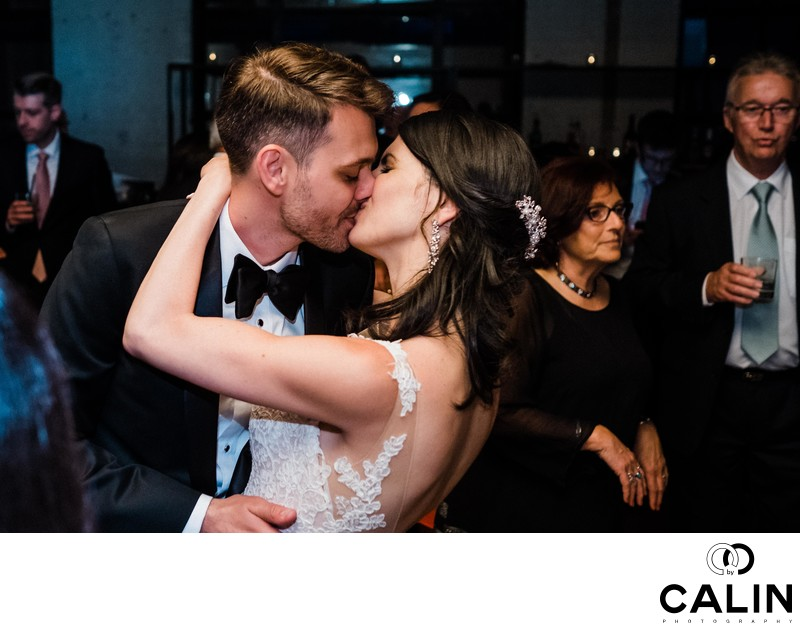 Bride and Groom Kiss at Storys Building Wedding