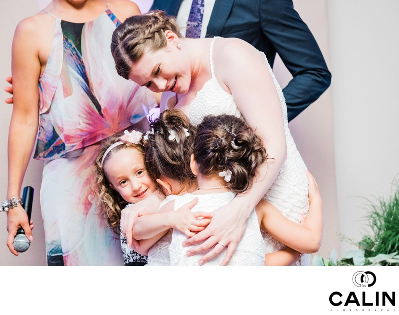 Bride Hugs Flower Girls