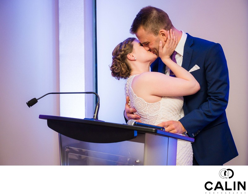 Newlyweds Kiss During Speech