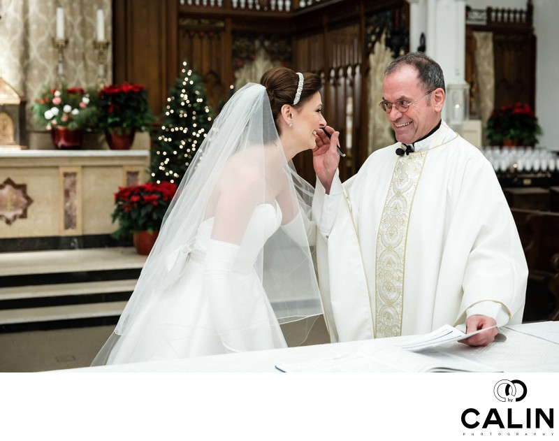 Priest Congratulates Bride
