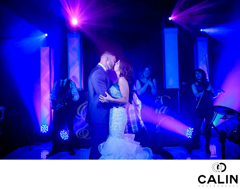 Bride and Groom Kiss on Dance Floor