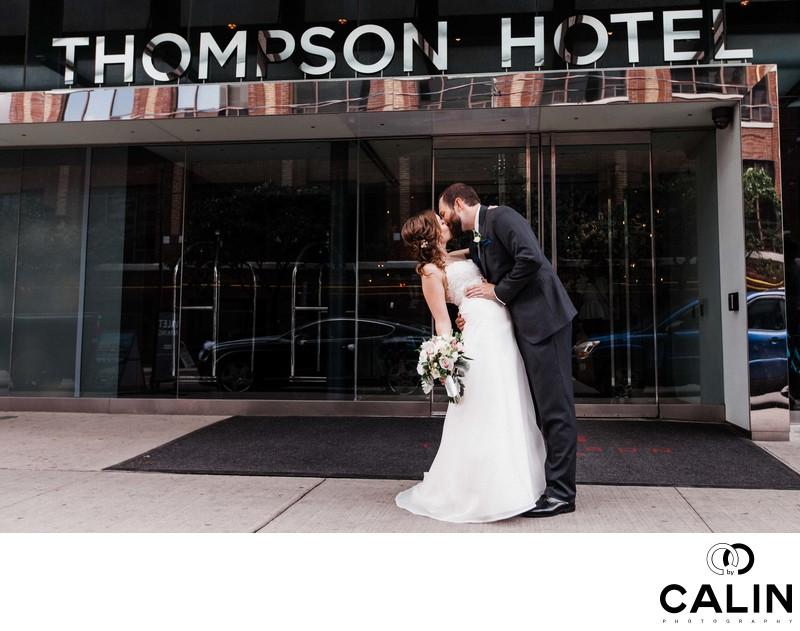 Groom Dips Bride in front of Thompson Hotel Toronto