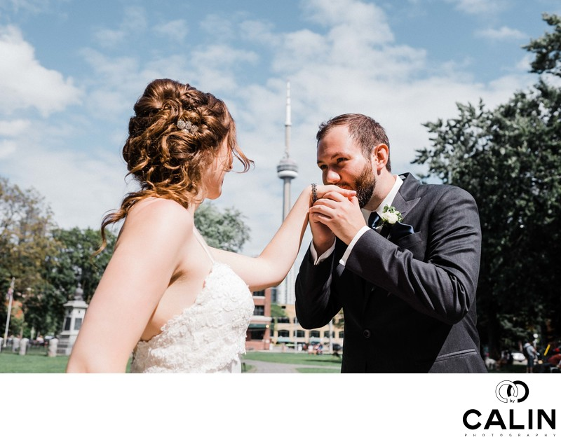 Groom Kisses Bride's Hand at Their Thompson Hotel Toronto Wedding