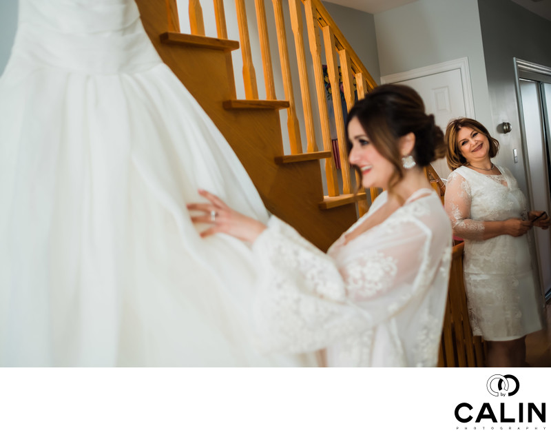 Bride Arranges Her Dress at Sassafraz Wedding