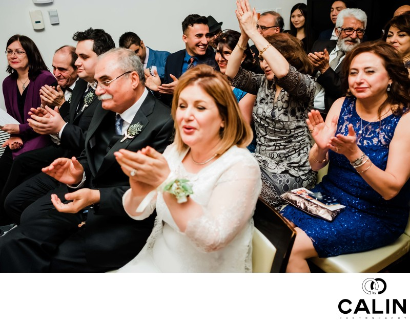 Guests Applaud Newlyweds at Sassafraz Wedding