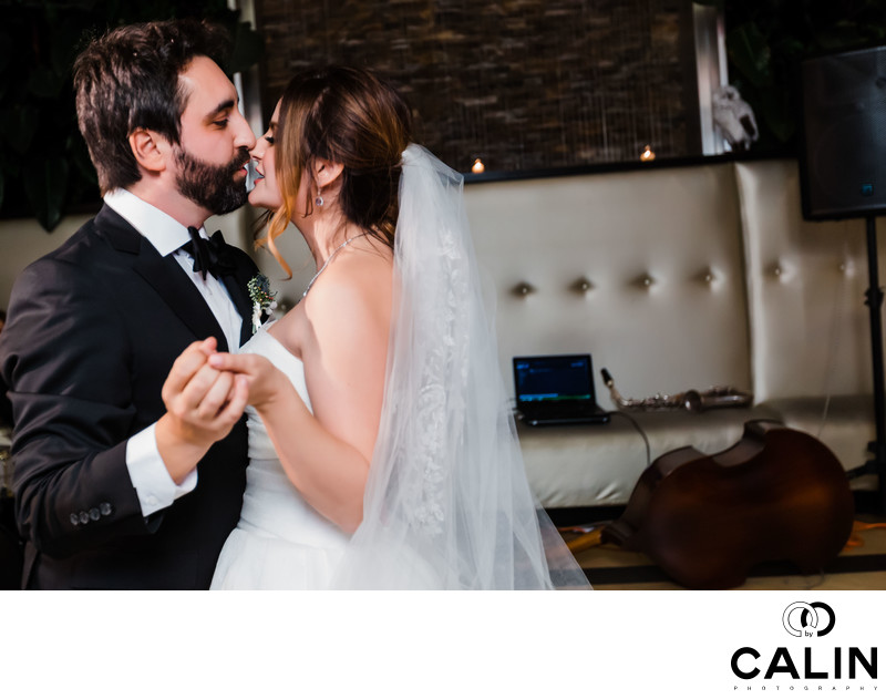 Couple Kiss During First Dance at Sassafraz Wedding