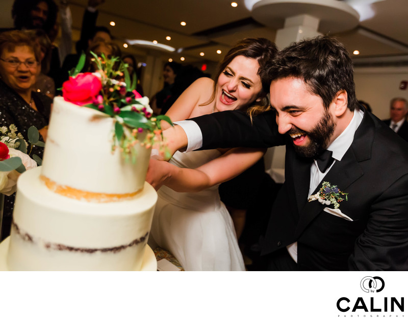 Couple Cuts Wedding Cake at Sassafraz Restaurant
