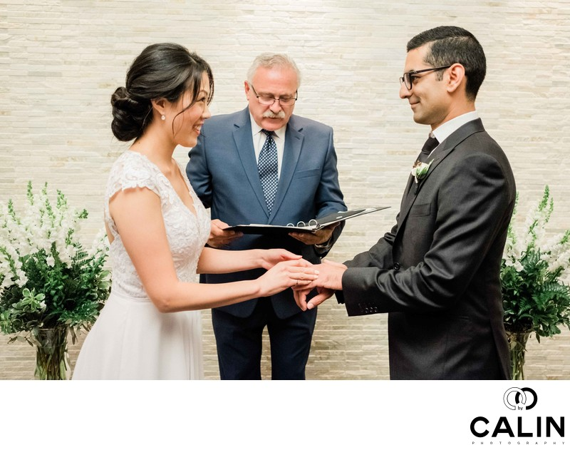 Couple Hold Hands at Sassafraz Restaurant Wedding Ceremony