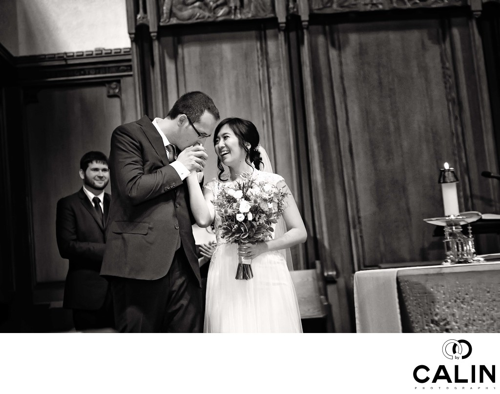 Groom Kisses Bride's Hand at St. Michael's Cathedral Basilica