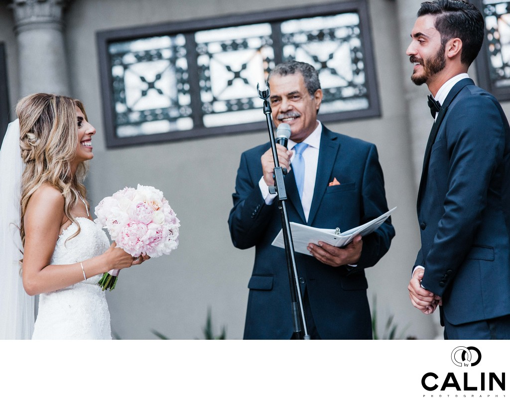 Couple and Officiant Laughing