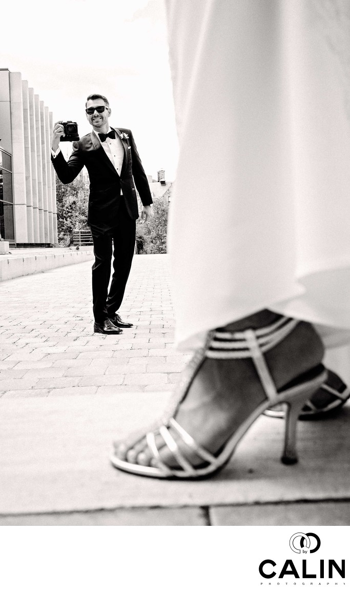 Groom Photographs Bride at Storys Building Wedding