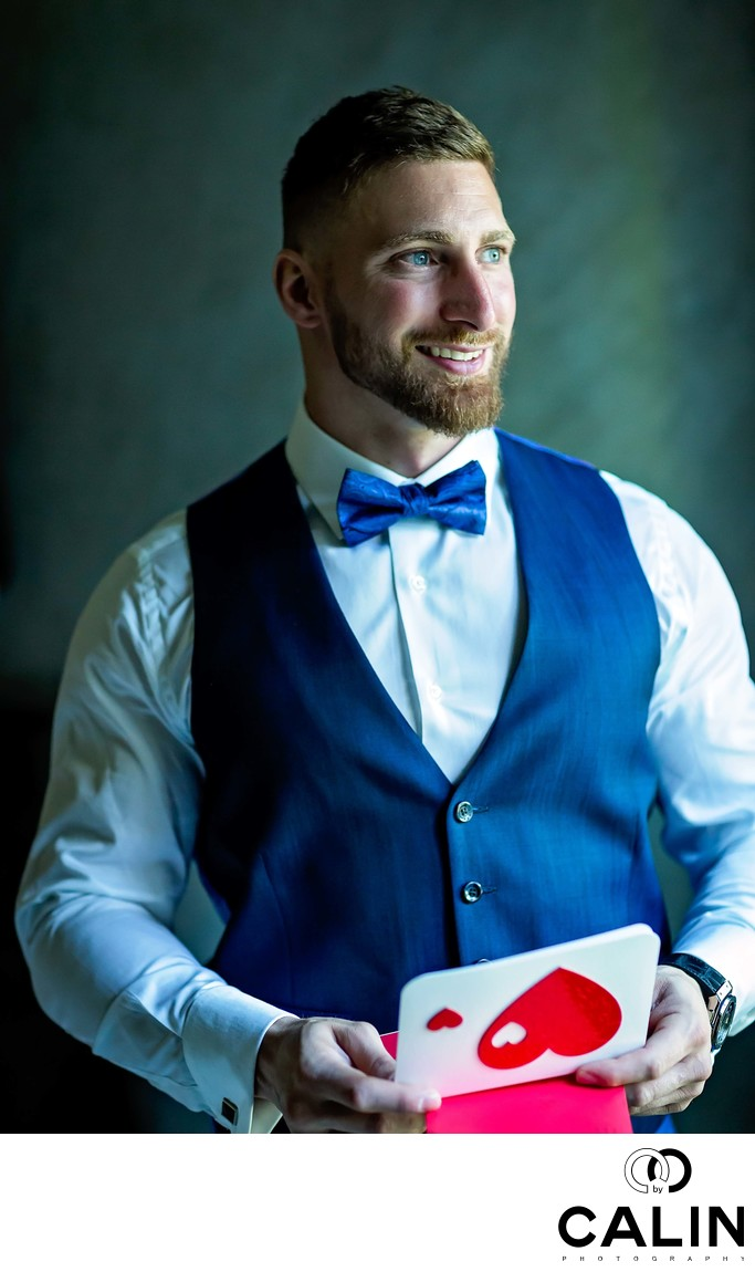 Groom Portrait Holding a Card