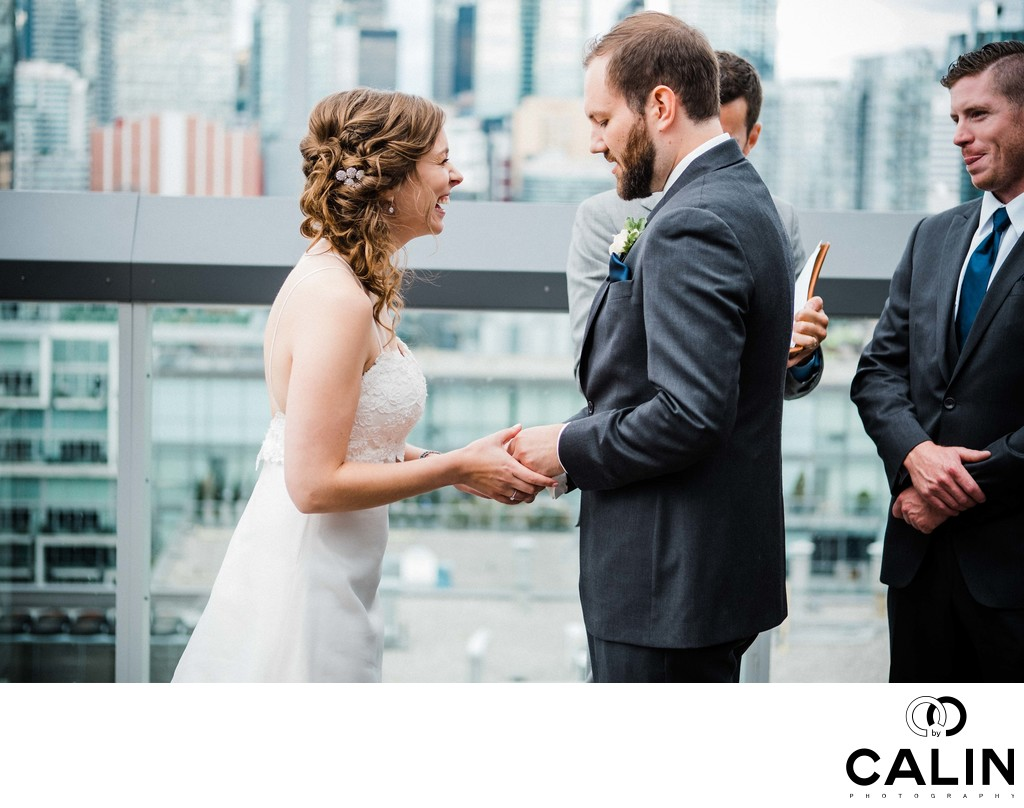 Bride Laughs During Ring Exchange at a Thompson Hotel Toronto Wedding