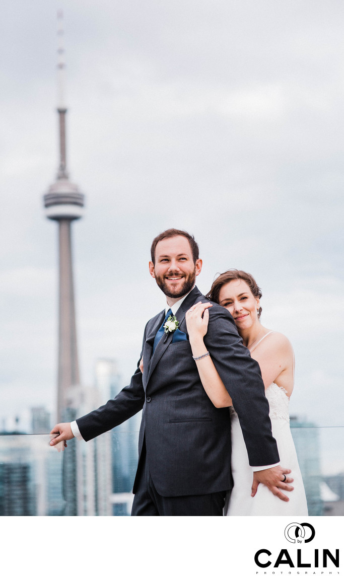 Bride and Groom Hug on Thompson Hotel Toronto Rooftop