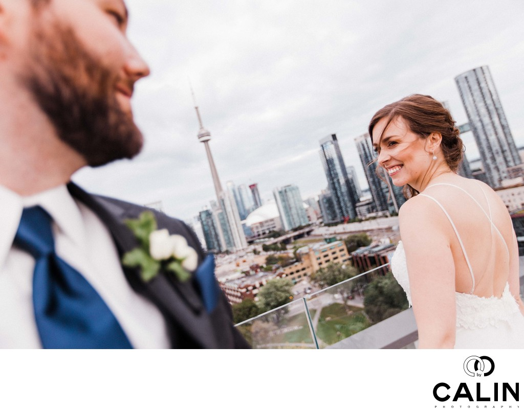 Bride and Groom Flirt on Top of Thompson Hotel Toronto