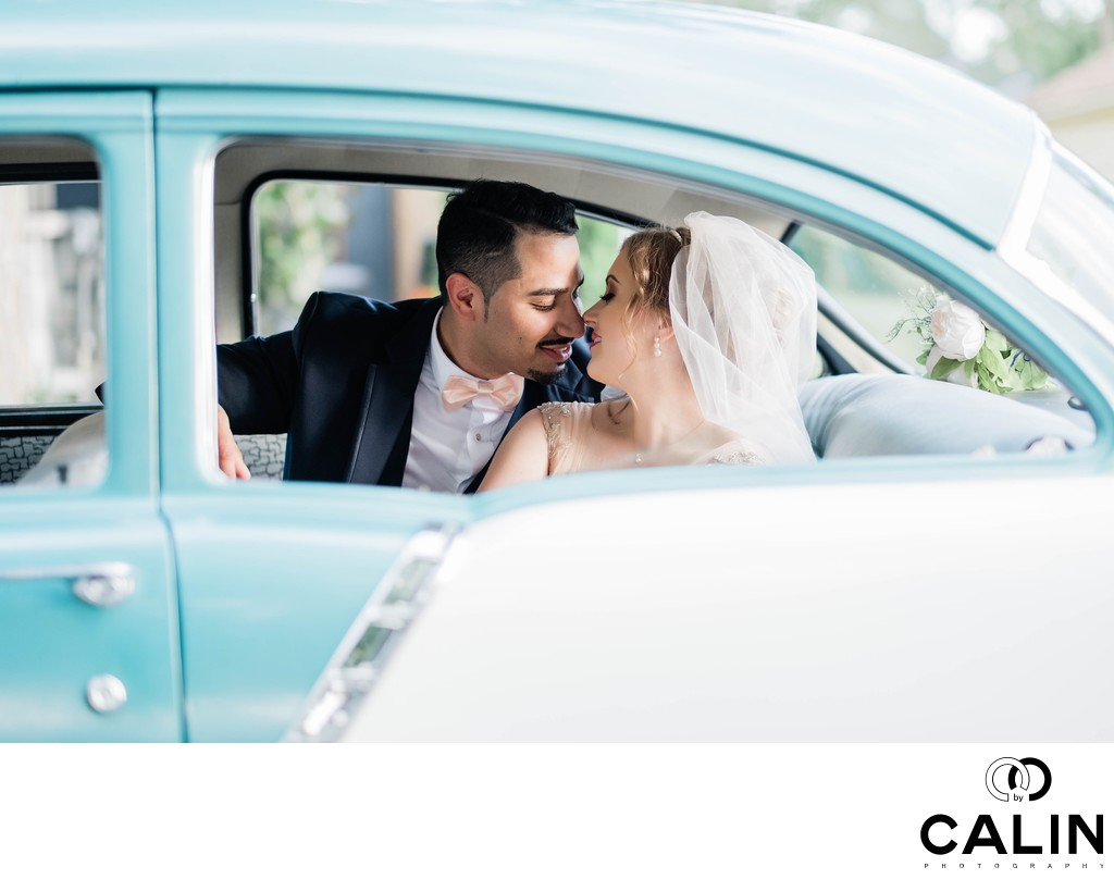 Bride and Groom Kiss in a Retro Car