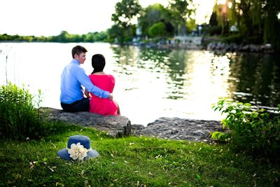 Engaged Photo of Couple Sitting by Lake Ontario