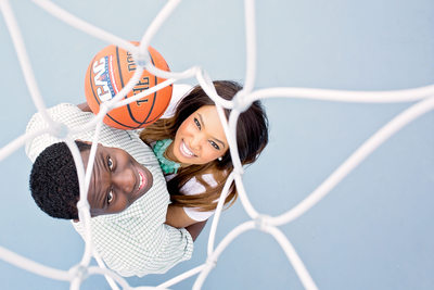 Engaged Couple Under a Basketball Hoop