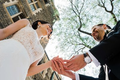 Bride and Groom Exchange Rings at Storys Building Wedding