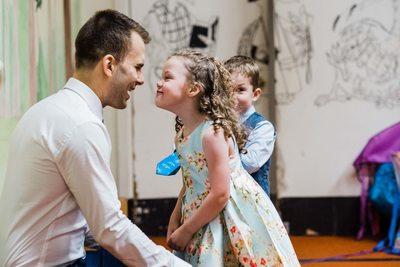Groom Plays With His Niece