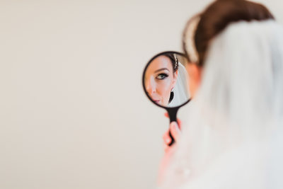 Beautiful Bride is Looking in the Mirror