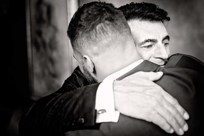 Groom Embraces His Father